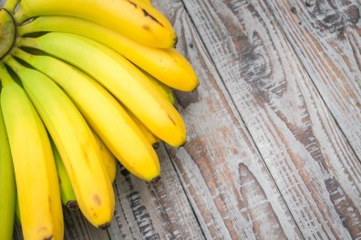 fresh-bananas-on-wooden-table_1232-3306.jpg
